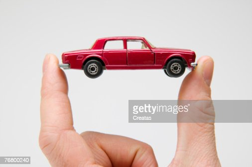 Hand holding miniature car : Stock Photo