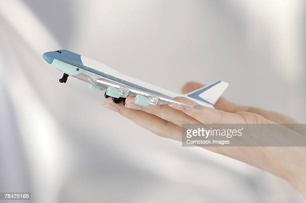 Hand holding model airplane