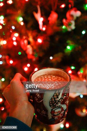 Hand Holding Mug of Hot Chocolate