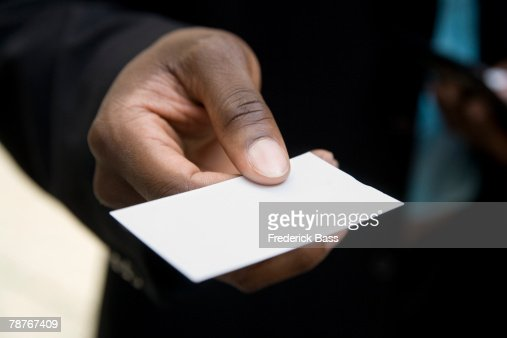 Technology Management Image: Hand Holding Out A Blank Business Card Stock Photo