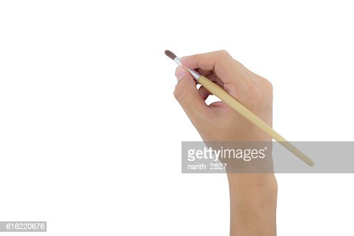 hand holding paint brush isolated over white background : Stock Photo