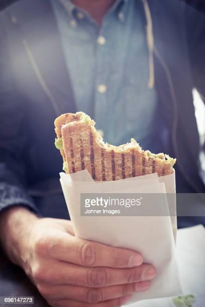 Hand holding Panini sandwich