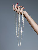 Hand holding pearl necklace