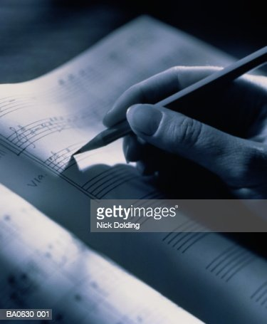 Hand holding pencil, transcribing musical score, close-up, B&W : Stockfoto