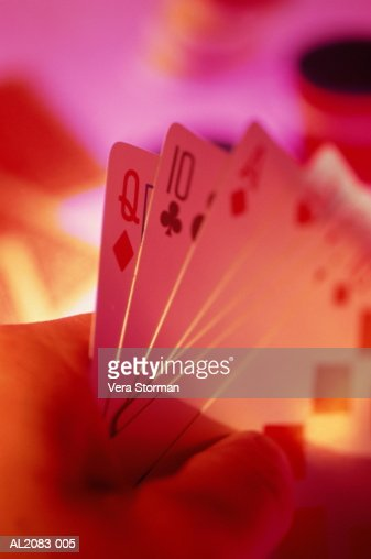 Hand holding playing cards, close-up : Stock Photo