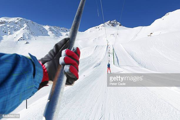Hand holding pole of ski lift