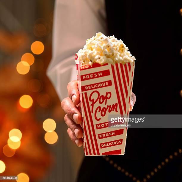Hand holding popcorn