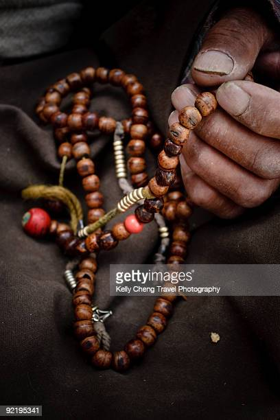 Hand holding Prayer Beads