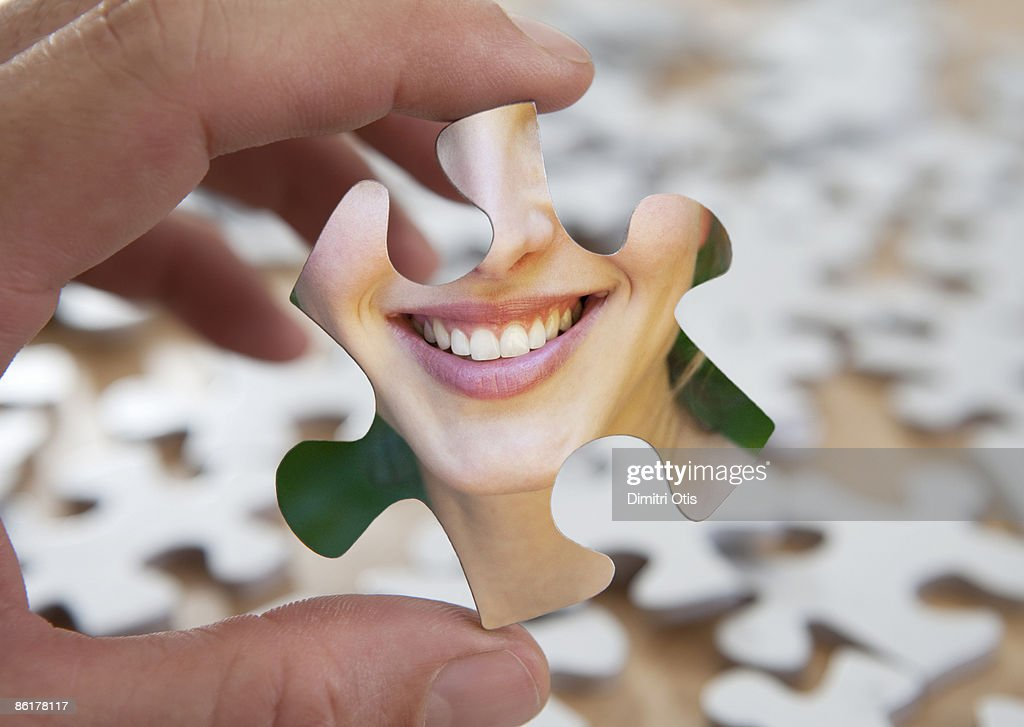 hand holding puzzle piece with smile : Stock Photo