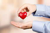 Hand holding red heart. Health care medicine and life concept