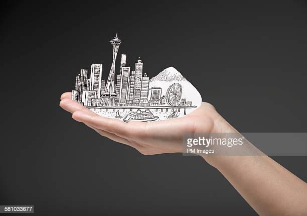 Hand holding Seattle, Washington