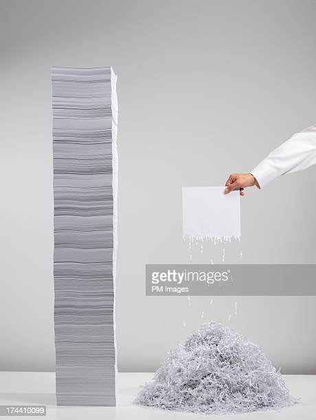 Hand holding shredded paper