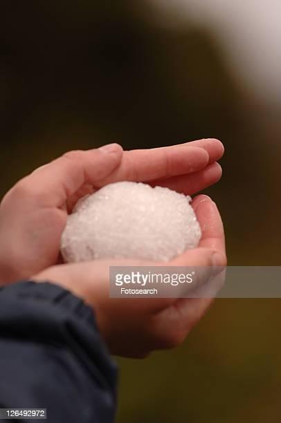 Hand holding snow ball