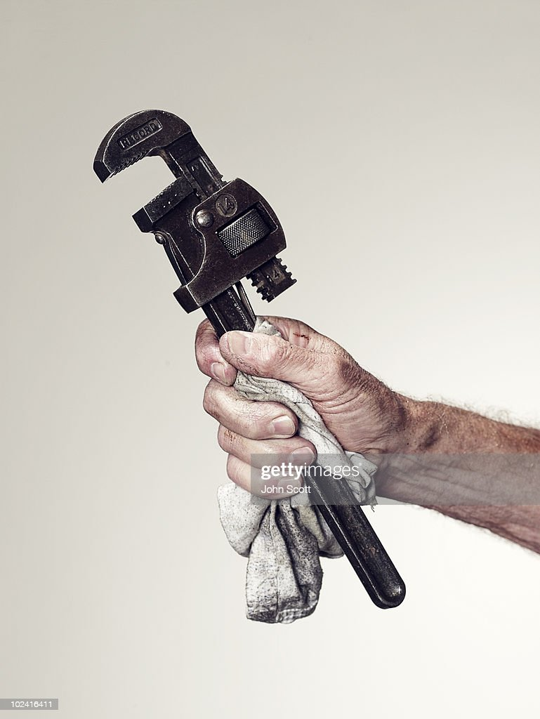 Hand holding spanner/wrench : Stock Photo