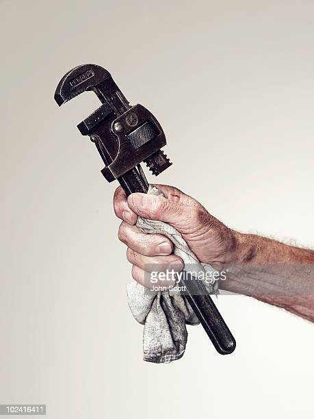 Hand holding spanner/wrench