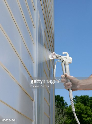 Paint spray gun stock photos and pictures getty images Exterior house painting spray gun