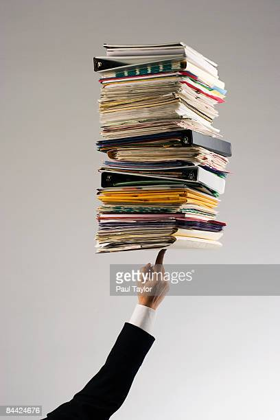 Hand holding stack of files