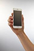 Hand holding up an Apple iPhone 6 taken on September 24 2014