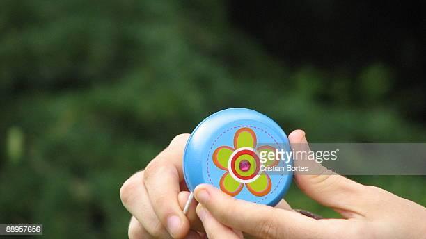 Hand holding Yo-Yo toy