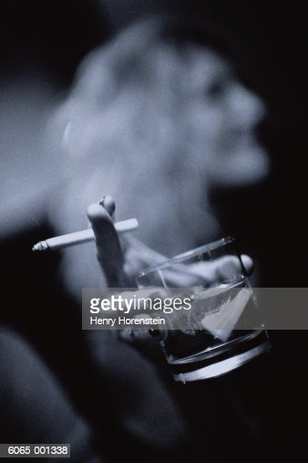 Hand Holds Cigarette and Drink : Stock Photo