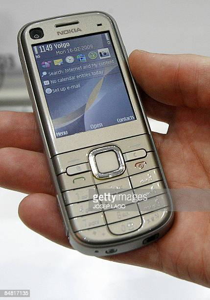 A hand holds Nokia's new model 6720 classic on show at the Mobile World Congress in Barcelona on February 16 2009 Samsung unveiled the world's first...