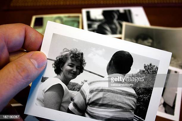 Hand holds Vintage photograph of 1950s husband and wife