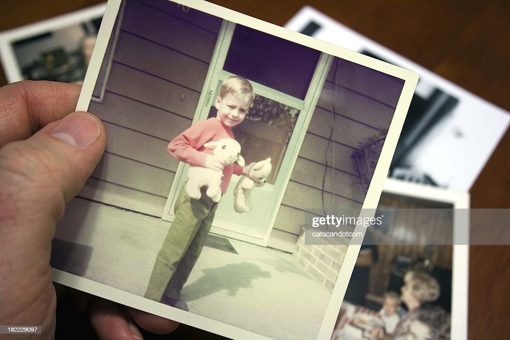Hand holds Vintage photograph of child during summer : Stock Photo