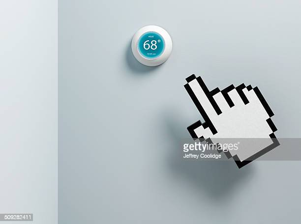 Hand Icon and Thermostat