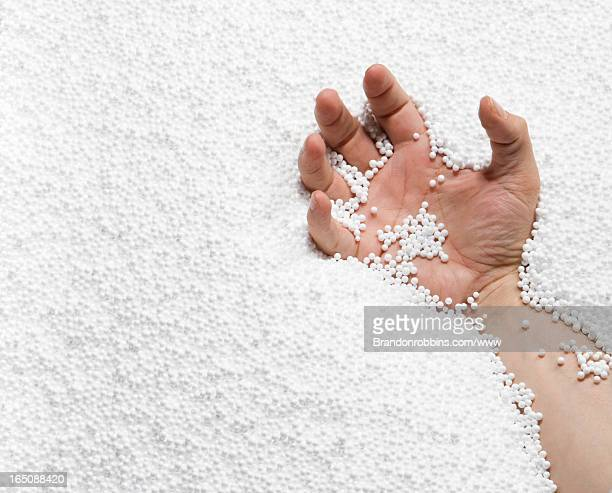 Hand in a pit of white