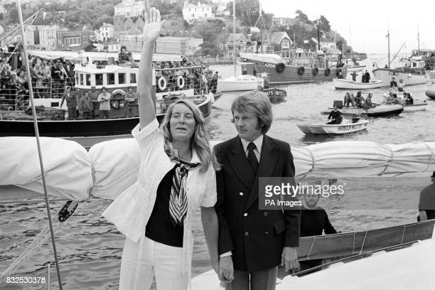 hand in hand with her husband Rob round the world yachtswoman Naomi James 29 waves to the cheering crowds greeting her at dartmouth on her arrival...