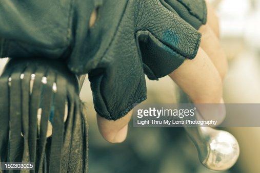Hand in motorbike handlebar