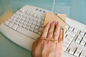 Hand in mousetrap on keyboard