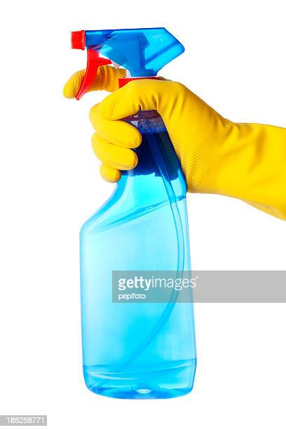 Hand in protective glove holding cleaning spray bottle