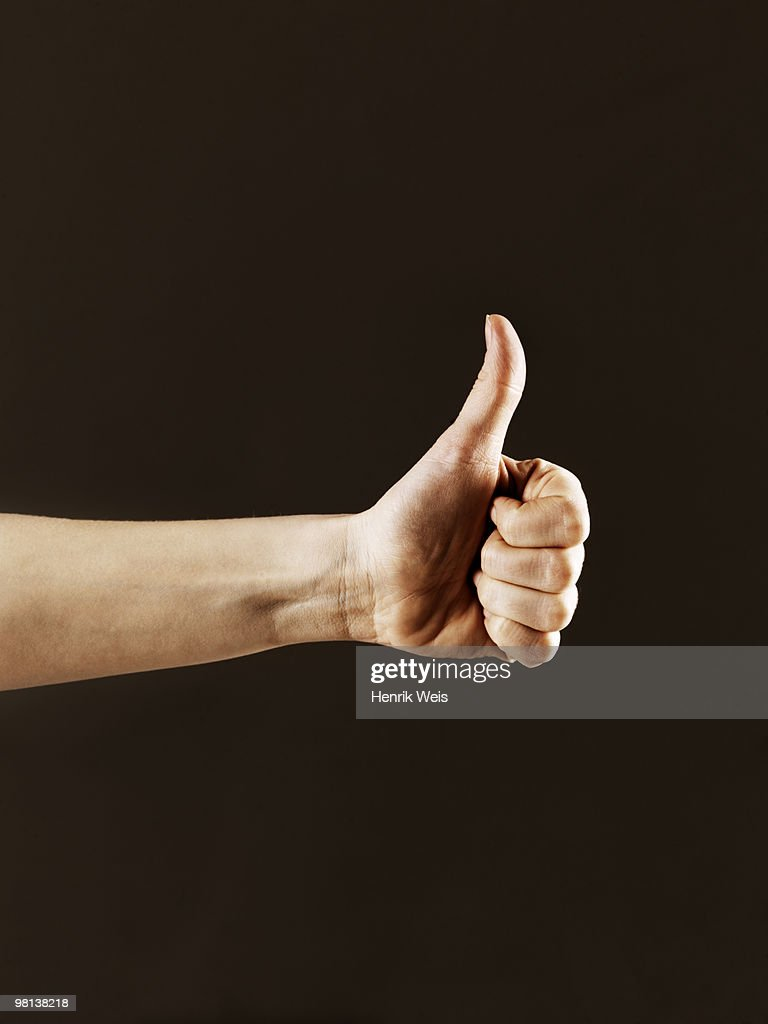 Hand indicating thumbs up : Stock Photo