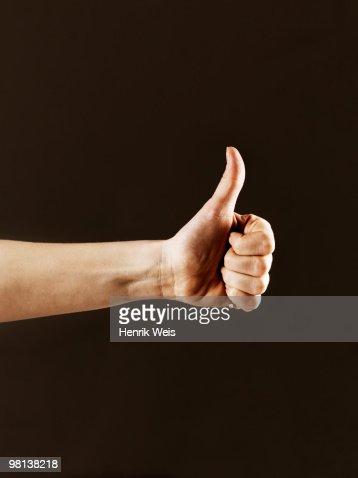 Hand indicating thumbs up : Stock Photo