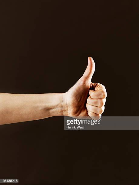 Hand indicating thumbs up