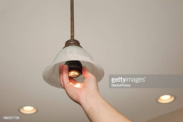 Hand Installing LED Light Bulb