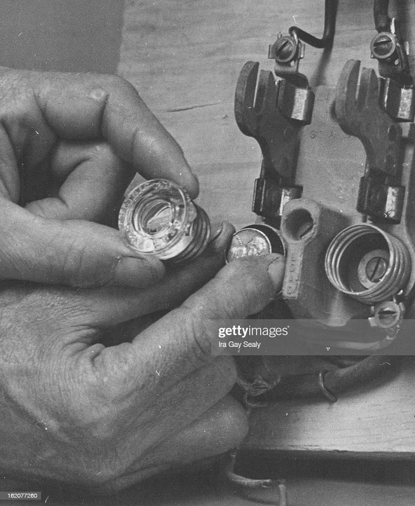 hand is shown demonstrating one of the home fire hazards aurora fire picture id162077260 oct 3 1969, oct 4 1969, oct 8 1969; hand is shown demonstrating penny in a fuse box at aneh.co