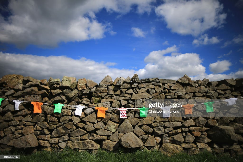 Hand knitted miniature jerseys, which will be used as bunting to decorate the streets and lanes of Harrogate when the Tour de France makes its way through Yorkshire, hang on a dry stone wall in the Yorkshire countryside on April 11, 2014 in Harrogate, England. Over 23000 hand knitted woollen jerseys have been made by volunteers to decorate the route of the Yorkshire Grand Depart of the Tour de France 2014 on July 5th, 2014.