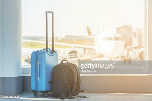 Hand luggage at the airport : Stock Photo