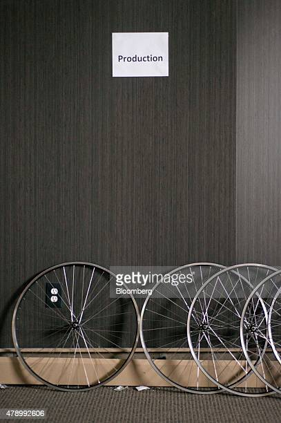 Hand made bicycle wheels lean against a wall at the Detroit Bike manufacturing facility in Detroit Michigan US on Thursday June 25 2015 The Institute...