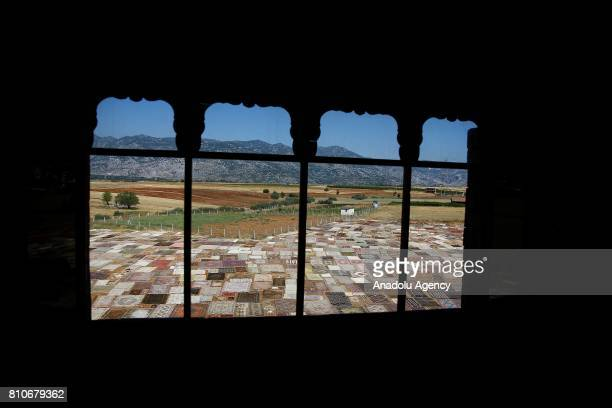 Hand made carpets brought from varied regions of Turkey are laid under the sun on a field to soften their color and disinfection in Dosemealti...