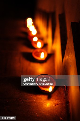 Hand made oil lamps decorated in the festive night of Hindu festival Diwali or Deepavali : Stock Photo