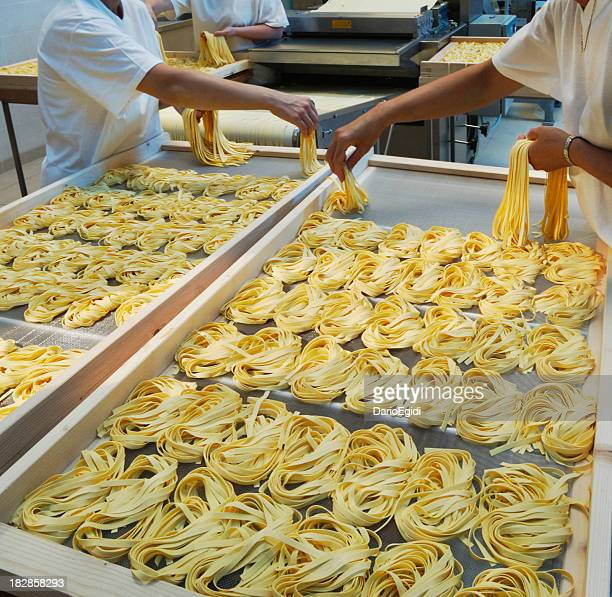 Hand made production of  tagliatelle (italian pasta)