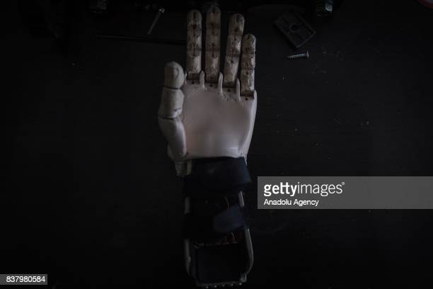 A hand made with a 3D printer making a part of the prosthesis with biodegradable plastic corn starch by volunteers of the nonprofit project 'Do it...
