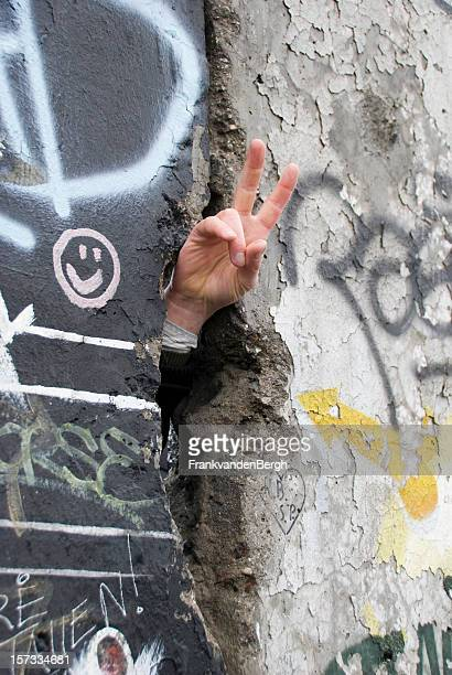 Hand making Peace Sign at Berlin Wall