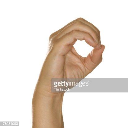 Hand making zero sign