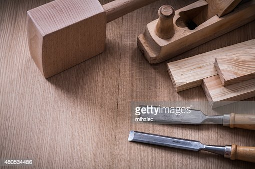 Hand mallet planer metal chisels and wooden stud on wood : Stock Photo