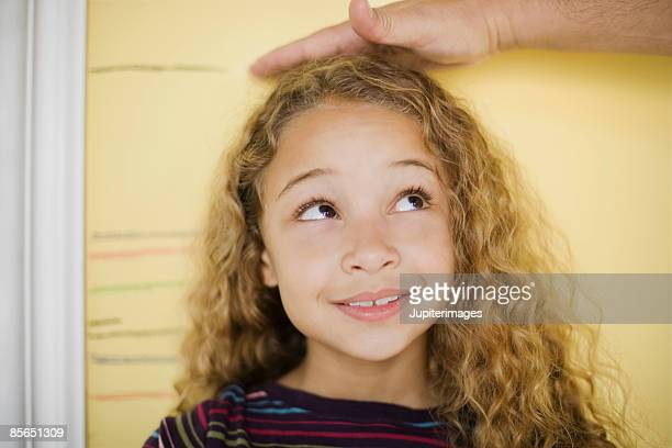 Hand measuring growing girl