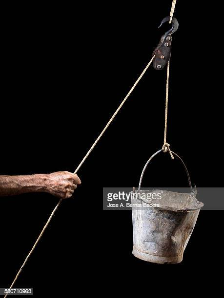 Hand of a man pulling strongly a rope